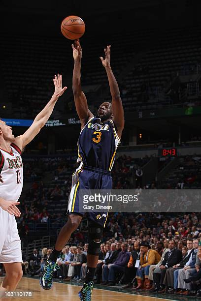 DeMarre Carroll of the Utah Jazz shoots against Mike Dunleavy of the Milwaukee Bucks on March 4 2013 at the BMO Harris Bradley Center in Milwaukee...