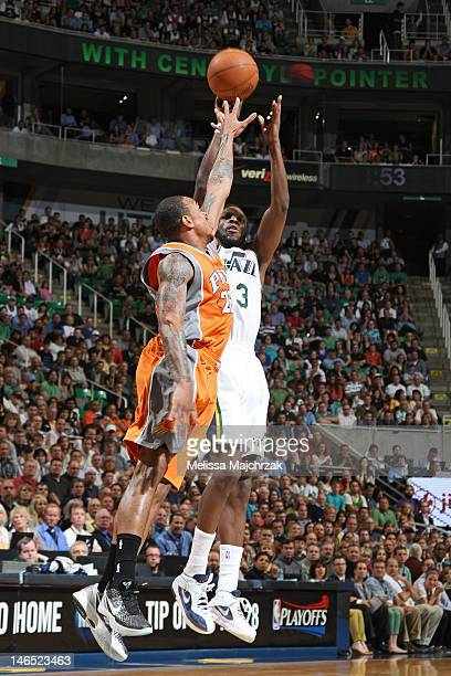 DeMarre Carroll of the Utah Jazz shoots against Shannon Brown of the Phoenix Suns at Energy Solutions Arena on April 24 2012 in Salt Lake City Utah...
