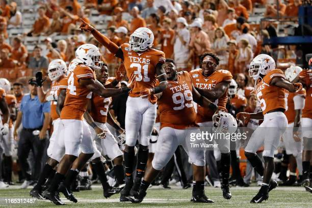 DeMarvion Overshown of the Texas Longhorns celebrates with teammates after an interception in the fourth quarter against the Louisiana Tech Bulldogs...