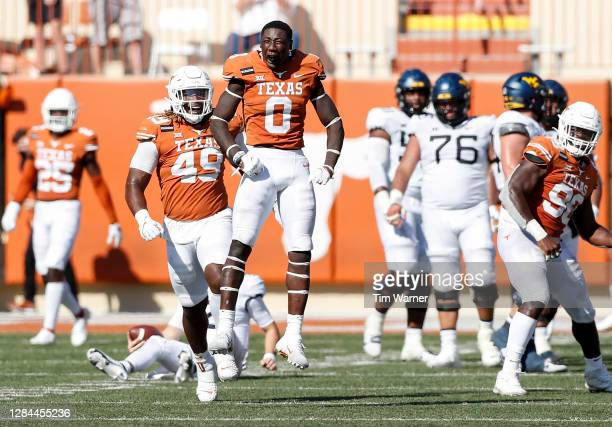 DeMarvion Overshown of the Texas Longhorns reacts after sacking Jarret Doege of the West Virginia Mountaineers in the third quarter at Darrell K...