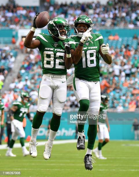 Demaryius Thomas and Jamison Crowder of the New York Jets celebrate a touchdown against the Miami Dolphins in the first quarter at Hard Rock Stadium...