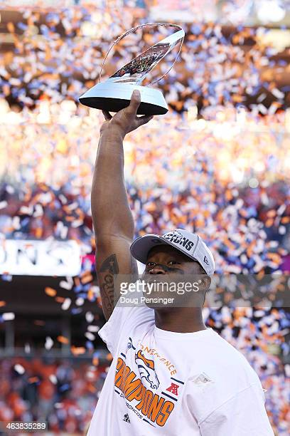 Demaryius Thomas of the Denver Broncos celebrates with the Lamar Hunt Trophy after they defeated the New England Patriots 26 to 16 in the AFC...