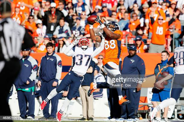 Demaryius Thomas of the Denver Broncos completes a fourth quarter reception against Alfonzo Dennard of the New England Patriots during the AFC...