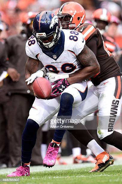 Demaryius Thomas of the Denver Broncos drops a pass as Pierre Desir of the Cleveland Browns defends during the second half of the Broncos' 26-23 win...
