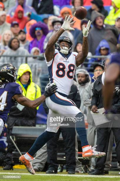 Demaryius Thomas of the Denver Broncos jumps for a pass in front of Brandon Carr of the Baltimore Ravens during the second half at MT Bank Stadium on...