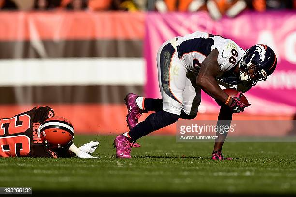 Demaryius Thomas of the Denver Broncos makes a catch as Pierre Desir of the Cleveland Browns falls to the turf during the second half of the Broncos'...