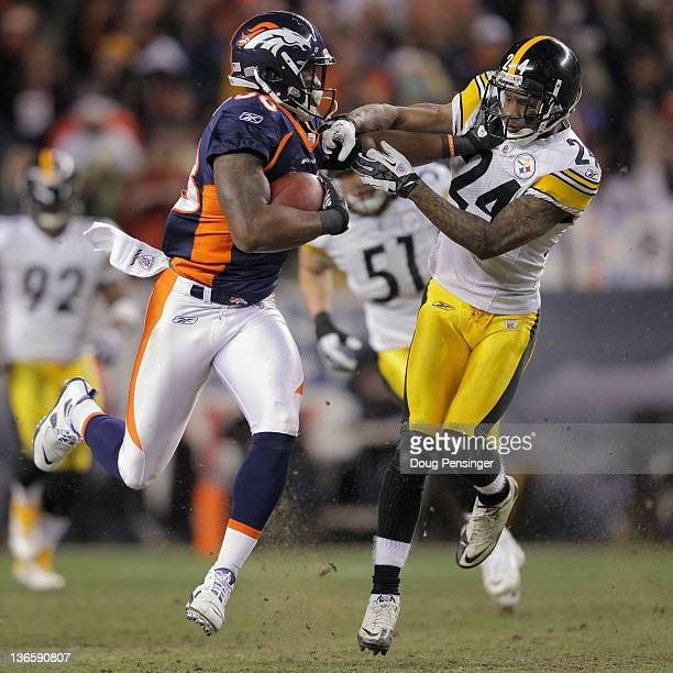 Demaryius Thomas of the Denver Broncos makes a pass reception and fights off Ike Taylor of the Pittsburgh Steelers to go 80 yards for the game...