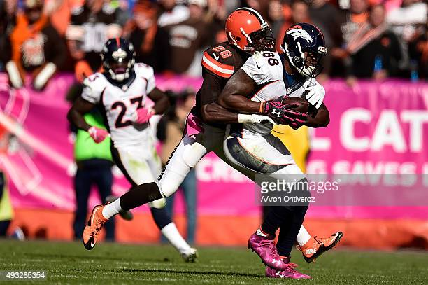 Demaryius Thomas of the Denver Broncos makes a pass reception as Pierre Desir of the Cleveland Browns defends during the second half of the Broncos'...