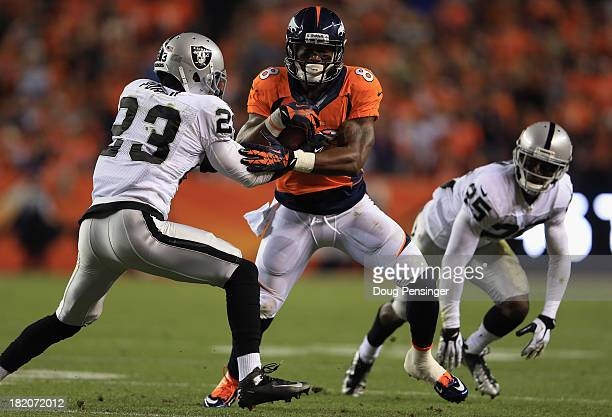Demaryius Thomas of the Denver Broncos makes a reception against Tracy Porter of the Oakland Raiders and DJ Hayden of the Oakland Raiders at Sports...