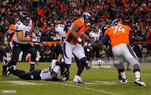 Demaryius Thomas of the Denver Broncos runs for yards after the catch to score a 17yard touchdown reception in the fourth quarter against the...