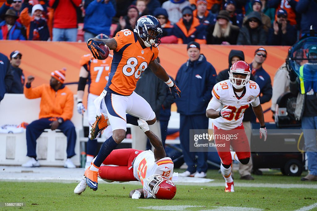Demaryius Thomas #88 of the Denver Broncos runs over Javier Arenas #21 of the Kansas City Chiefs during the game at Sports Authority Field at Mile High on December 30, 2012 in Denver, Colorado.