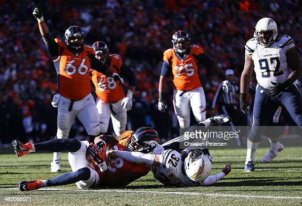 Demaryius Thomas of the Denver Broncos scores a first quarter touchdown against the defense of Eric Weddle of the San Diego Chargers during the AFC...