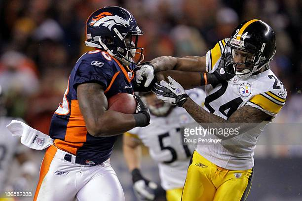 Demaryius Thomas of the Denver Broncos stiff arms Ike Taylor of the Pittsburgh Steelers to score an 80 yard touchdown in overtime during the AFC Wild...