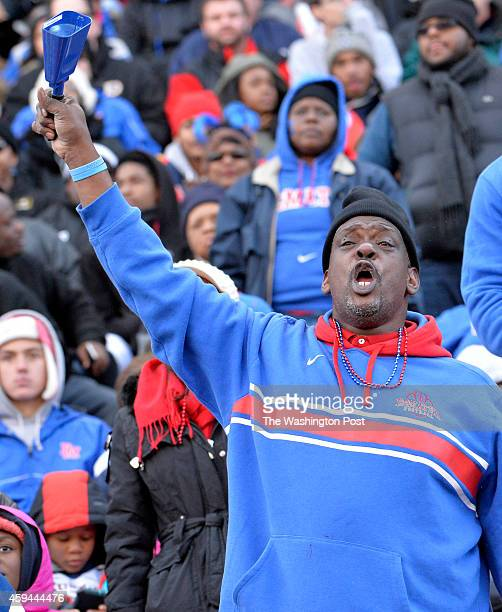 DeMatha fan looked to rally the team just before halftime against Good Counsel in the Washington Catholic Athletic Conference football championship...