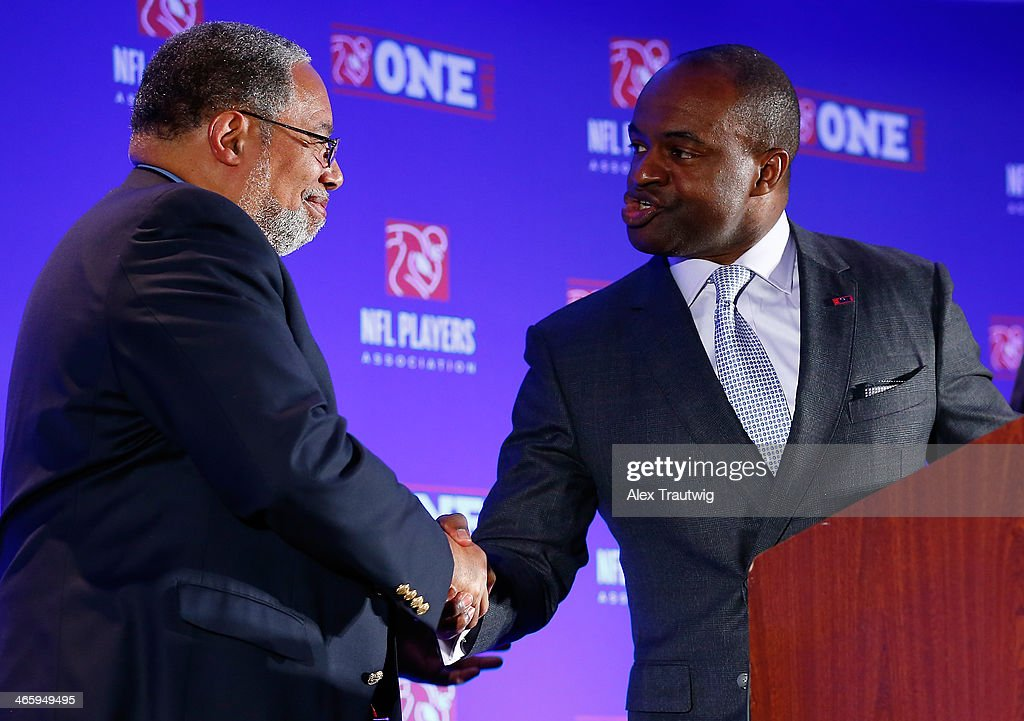 DeMaurice Smith, Executive Director of the National Football League Players Association, greets Lonnie Bunch, Director of the National Museum of African American History and Culture during an NFLPA press conference prior to Super Bowl XLVIII on January 30, 2014 in New York City.