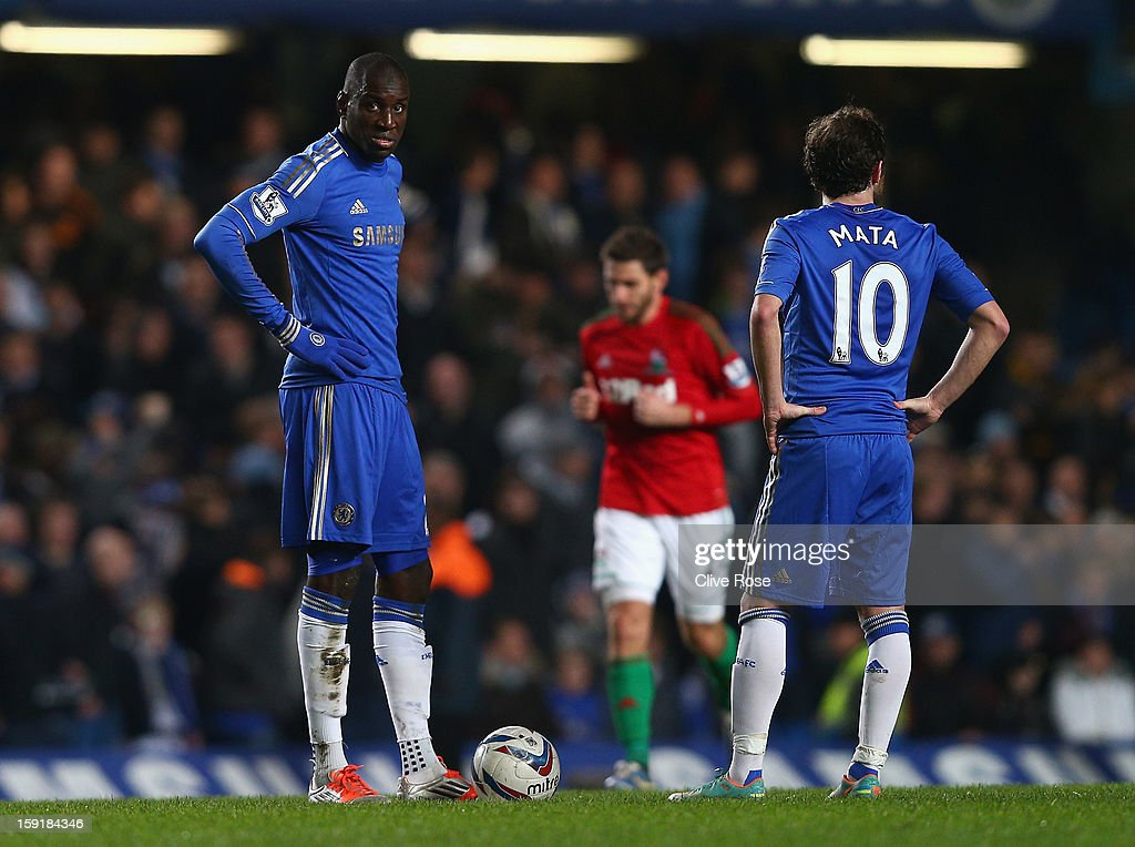 Demba Ba and Juan Mata of Chelsea look dejected after the second Swansea goal during the Capital One Cup Semi-Final first leg match between Chelsea and Swansea City at Stamford Bridge on January 9, 2013 in London, England.