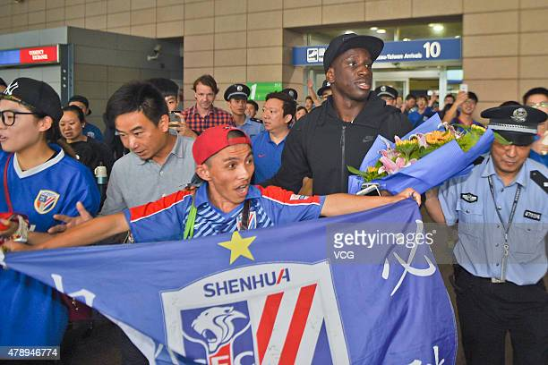 Demba Ba arrives at Pudong International Airport on June 28 2015 in Shanghai China Demba Ba will sign a threeyear contract with Chinese Super League...