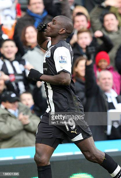 Demba Ba celebrates after scoring the first goal during the Barclays Premier League match between Newcastle United and Aston villa at The Sports...