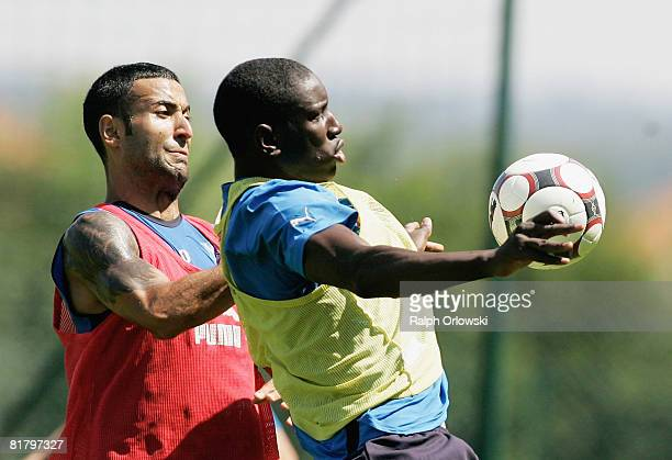 Demba Ba challenges Selim Teber during a training session of TSG 1899 Hoffenheim at their training camp on July 2, 2008 in Stahlhofen near Limburg,...