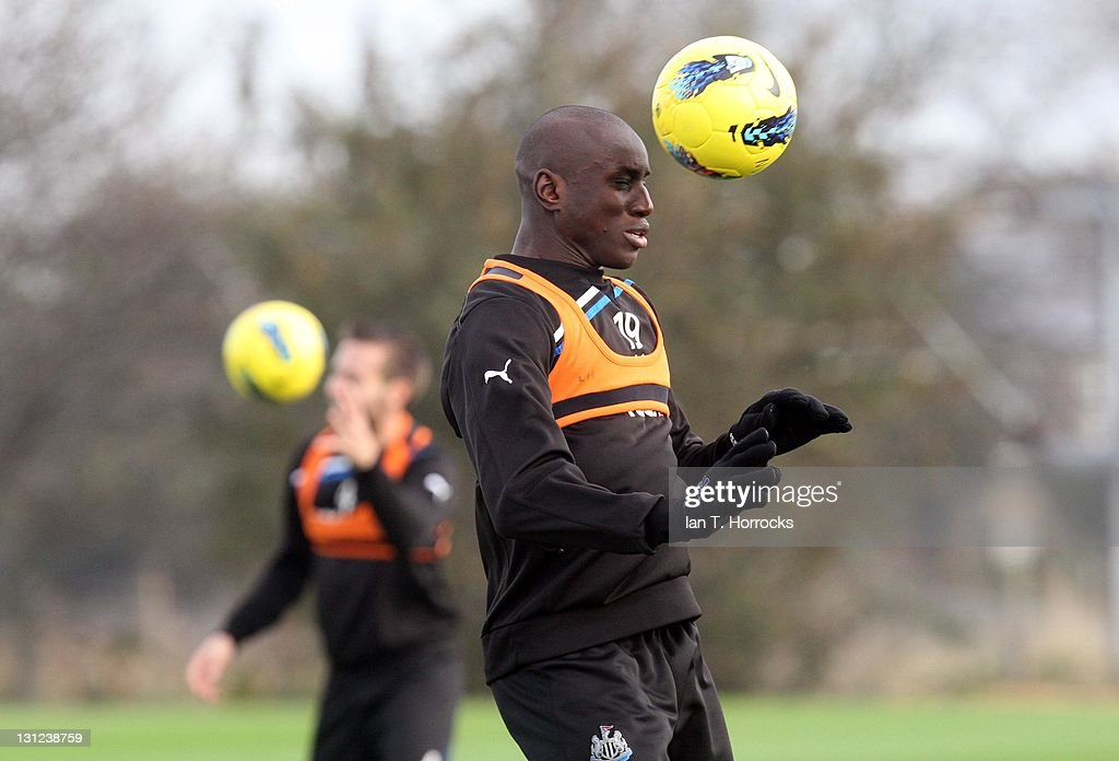 Demba Ba heads the ball during a Newcastle United Training session at The Little Benton Training Ground on November 03, 2011 in Newcastle, United Kingdom.