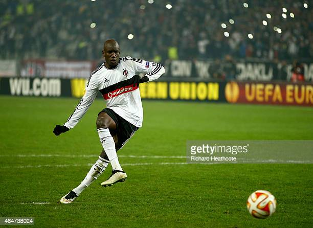 Demba Ba of Besiktas scores his penalty in the shoot out during the 2nd leg of the UEFA Europa League Round of 32 match between Besiktas and...