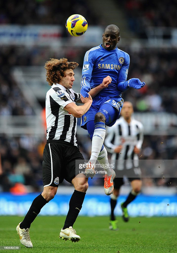 Demba Ba of Chelsea battles with Fabricio Coloccini of Newcastle United during the Barclays Premier League match between Newcastle United and Chelsea at St James' Park on February 2, 2013 in Newcastle upon Tyne, England.