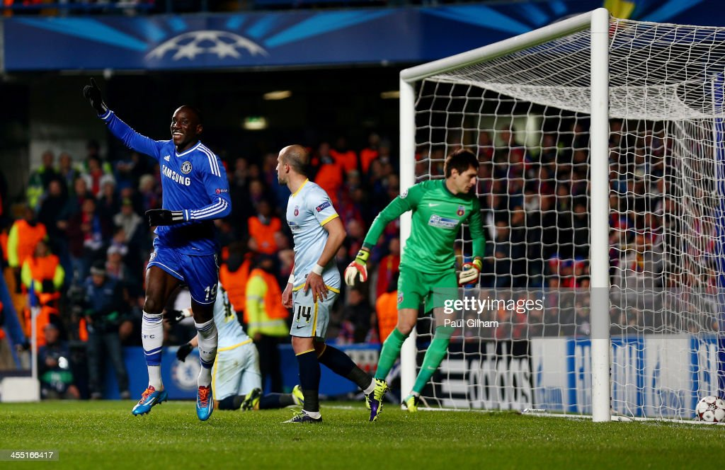 Demba Ba of Chelsea celebrates after scoring the opening goal during the UEFA Champions League Group E match between Chelsea and FC Steaua Bucuresti at Stamford Bridge on December 11, 2013 in London, England.