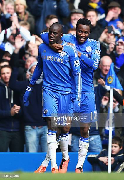 Demba Ba of Chelsea celebrates his goal with team mate Mikel during the FA Cup with Budweiser Sixth Round Replay match between Chelsea and Manchester...