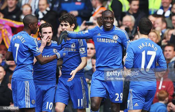 Demba Ba of Chelsea celebrates the opening goal with team mates during the Barclays Premier League match between Chelsea and West Bromwich Albion at...