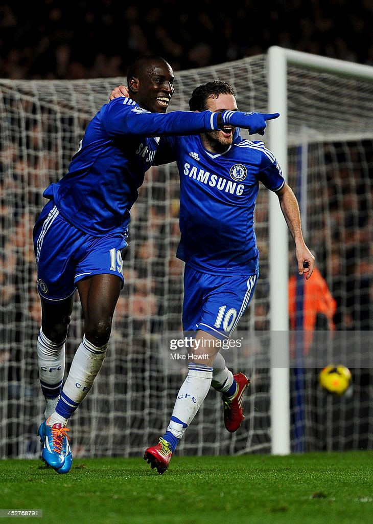 Demba Ba of Chelsea (L) celebrates with Juan Mata (R) as he scores their third goal during the Barclays Premier League match between Chelsea and Southampton at Stamford Bridge on December 1, 2013 in London, England.
