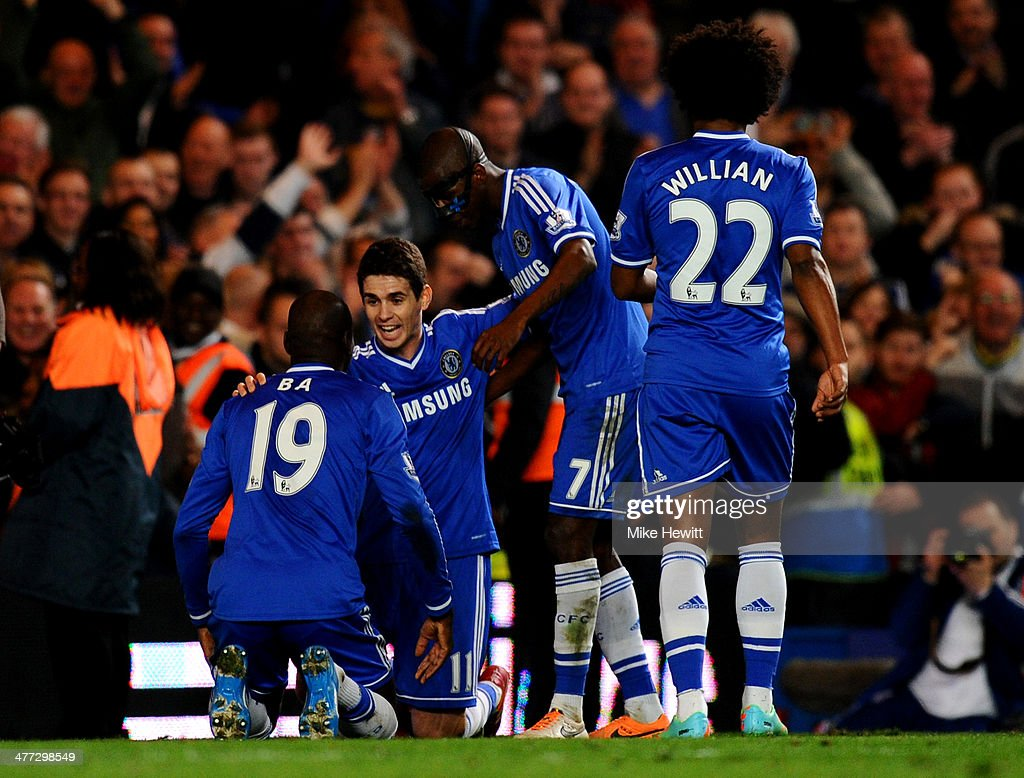 Demba Ba #19 of Chelsea celebrates with teammates Oscar, Ramires and Willian after scoring his team's fourth goal during the Barclays Premier League match between Chelsea and Tottenham Hotspur at Stamford Bridge on March 8, 2014 in London, England.