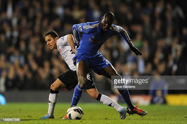 Demba Ba of Chelsea challenges for the ball with Kerim Frei of Fulham during the Barclays Premier League match between Fulham and Chelsea at Craven...