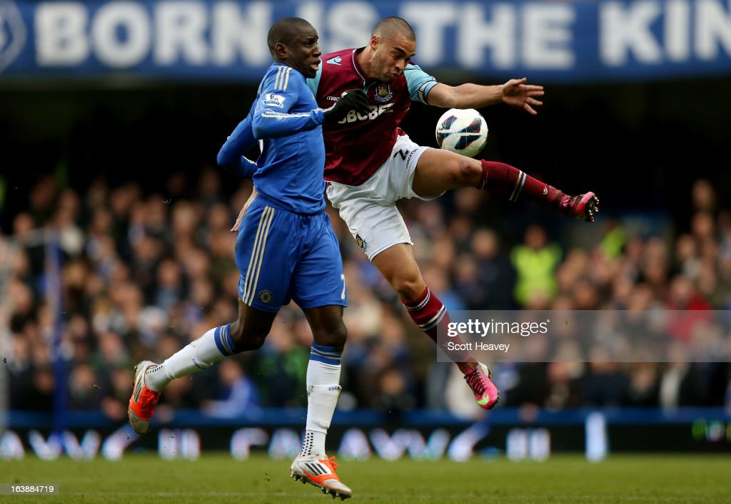 Demba Ba of Chelsea (L) challenges Winston Reid of West Ham during the Barclays Premier League match between Chelsea and West Ham United at Stamford Bridge on March 17, 2013 in London, England.