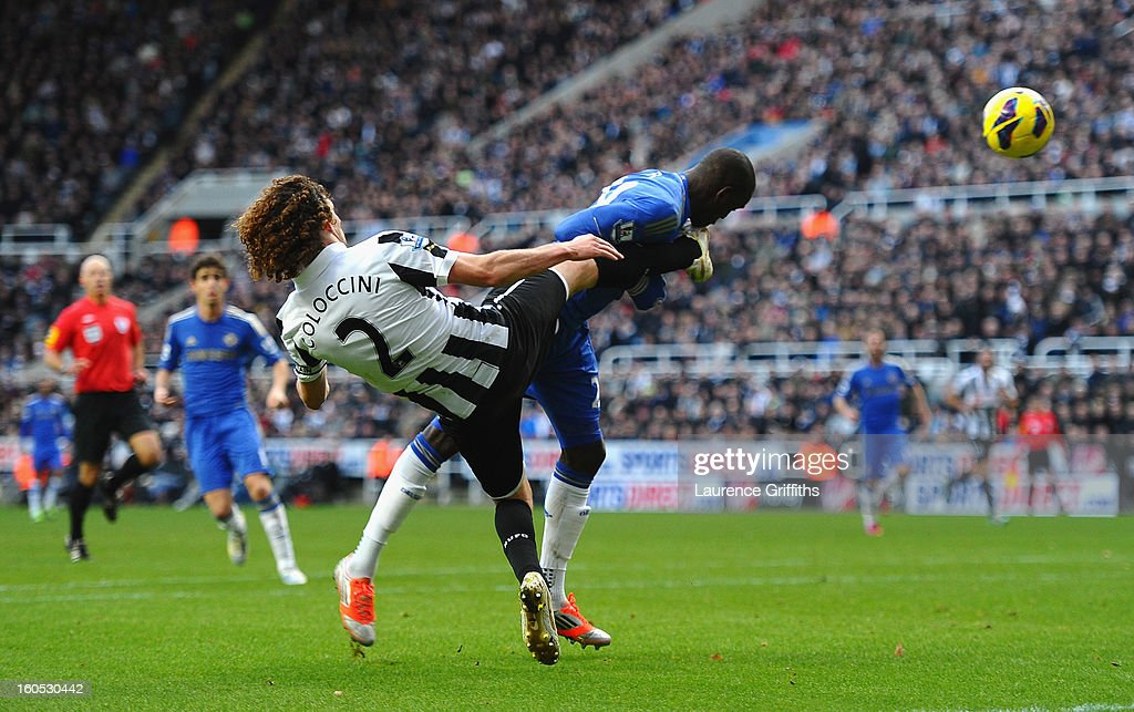 Demba Ba of Chelsea is kicked in the face by Fabricio Coloccini of Newcastle United during the Barclays Premier League match between Newcastle United and Chelsea at St James' Park on February 2, 2013 in Newcastle upon Tyne, England.