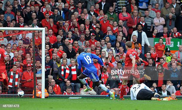 Demba Ba of Chelsea scores to make it 01 during the Barclays Premier League match between Liverpool and Chelsea at Anfield on April 27 2014 in...