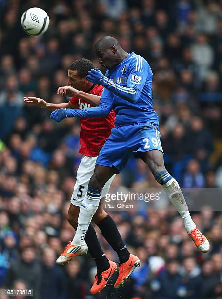 Demba Ba of Chelsea wins a header against Rio Ferdinand of Manchester United during the FA Cup with Budweiser Sixth Round Replay match between...