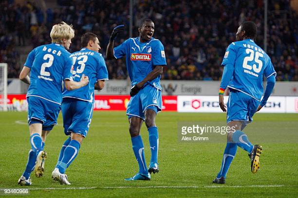 Demba Ba of Hoffenheim celebrates scoring his team's first goal with team mates Andreas Beck Sejad Salihovic and Isaac Vorsah during the Bundesliga...