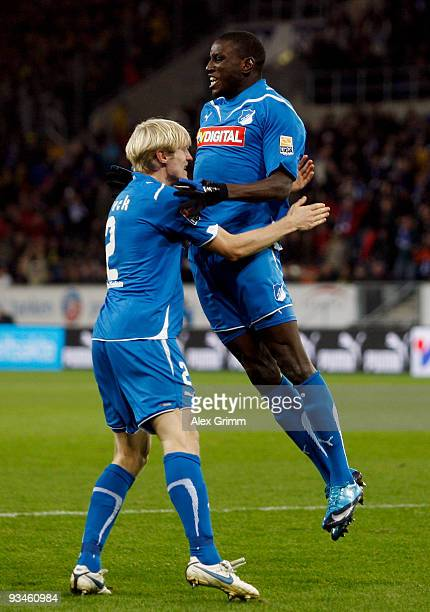 Demba Ba of Hoffenheim celebrates scoring his team's first goal with team mate Andreas Beck of Hoffenheim during the Bundesliga match between 1899...
