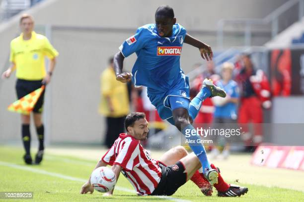 Demba Ba of Hoffenheim is challenged by Steed Malbranque of Sunderland during the preseason friendly match between 1899 Hoffenheim and Sunderland AFC...