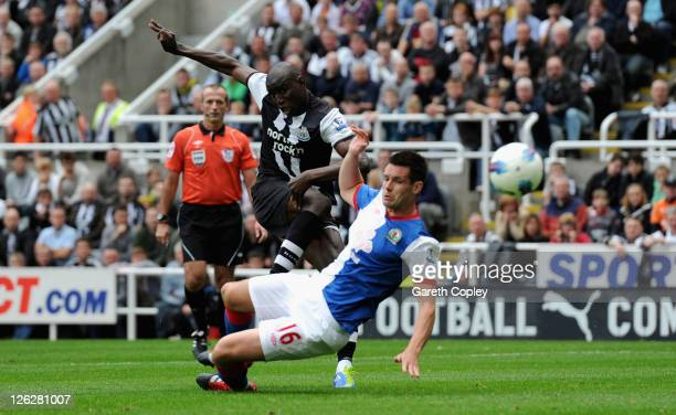 Demba Ba of Newcastle scores his team's opening goal past Scott Dann of Blackburn during the Barclays Premier League match between Newcastle United...