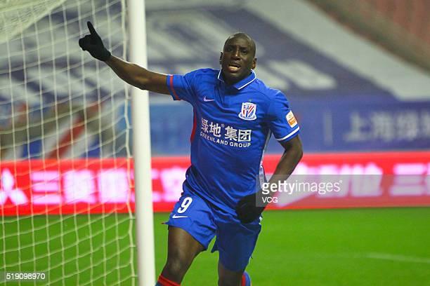Demba Ba of Shanghai Shenhua celebrates after scoring a goal during the Chinese Football Association Super League match between Shanghai Shenhua and...