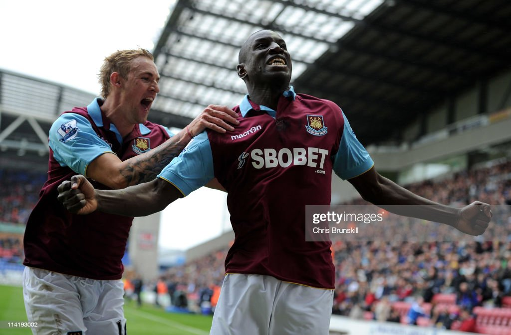 Demba Ba of West Ham United celebrates scoring the openng goal with team mate Jack Collison (L) during the Barclays Premier League match between Wigan Athletic and West Ham United at the DW Stadium on May 15, 2011 in Wigan, England.