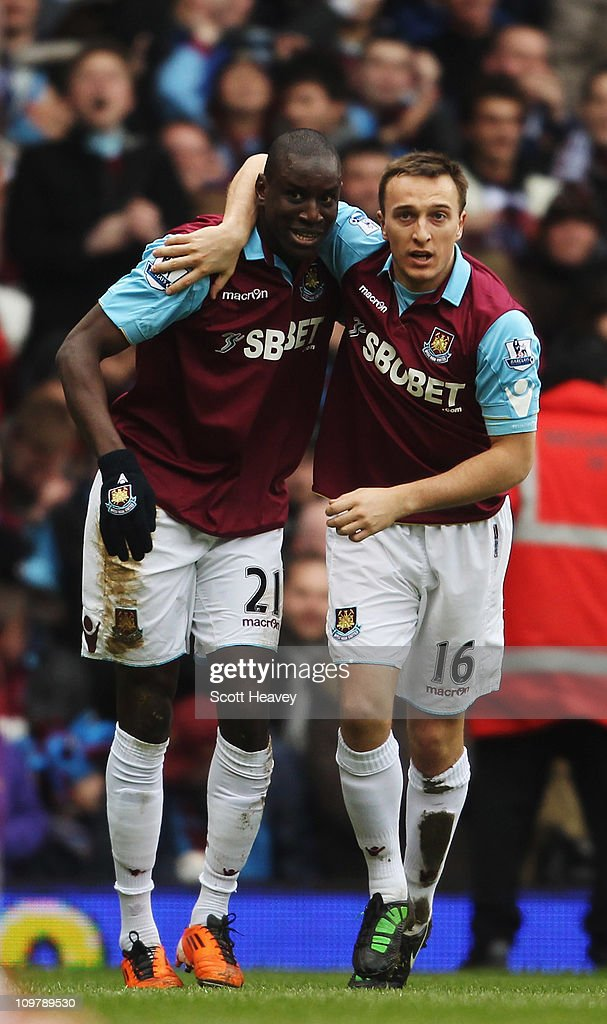 Demba Ba (L) of West Ham United celebrates with team mate Mark Noble after scoring during the Barclays Premier League match between West Ham United and Stoke City at the Boleyn Ground on March 5, 2011 in London, England.