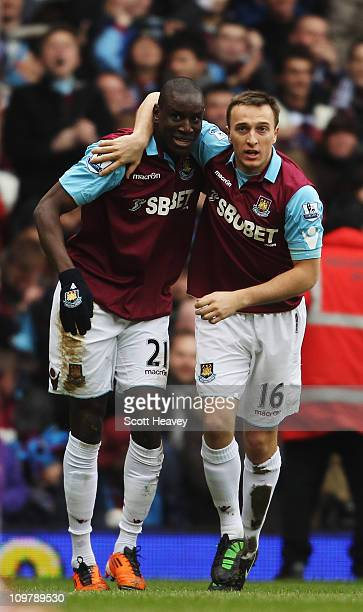 Demba Ba of West Ham United celebrates with team mate Mark Noble after scoring during the Barclays Premier League match between West Ham United and...