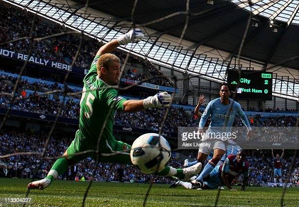 Demba Ba of West Ham United scores his team's first goal past Joe Hart of Manchester City during the Barclays Premier League match between Manchester...