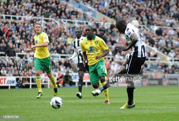 Demba Ba scores the opening goal during the Barclays Premier League match between Newcastle United and Norwich City at Sports Direct Arena on...