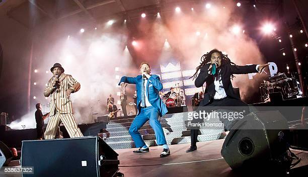 Demba 'Boundzound' Nabe Peter Fox and Frank A Delle singer of the band Seeed perform live during the Peace X Peace Festival at the Waldbuehne on June...