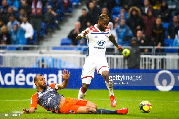Dembele Moussa of Lyon and Hilton of Montpellier during the Ligue 1 match between Lyon and Montpellier at Groupama Stadium on March 17, 2019 in Lyon,...