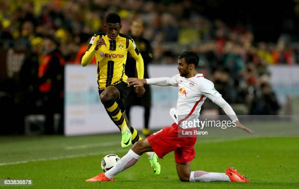 Dembele of Dortmund is challenged by Marvin Compper of Leipzig during the Bundesliga match between Borussia Dortmund and RB Leipzig at Signal Iduna...