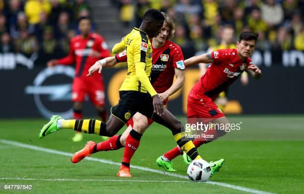 Dembele of Dortmund scores the opening goal during the Bundesliga match between Borussia Dortmund and Bayer 04 Leverkusen at Signal Iduna Park on...